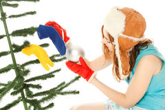 Woman dressing christmas tree Royalty Free Stock Images