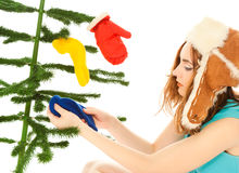 Woman dressing christmas tree Stock Photo