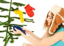 Woman dressing christmas tree Stock Photo