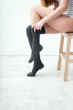 Woman dressing gaiters Royalty Free Stock Images