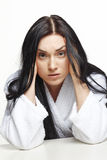 Woman in dressing gown Stock Image
