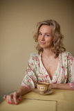 A woman in a dressing gown Royalty Free Stock Photography