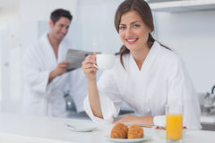 Woman with a dressing gown having breakfast Stock Photo