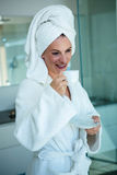 woman in a dressing gown holding a cup and saucer Stock Images