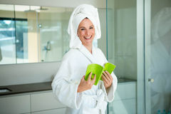 woman in a dressing gown reading a book Royalty Free Stock Photography
