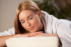 Woman in dressing gown in spa Stock Photo