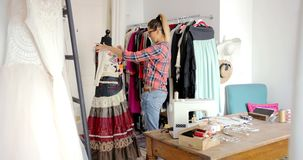 Woman dressing mannequin stock video footage