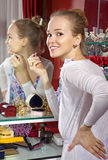 Woman in dressing room Royalty Free Stock Images
