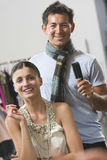 Woman In Dressing Room With Male Hair Stylist Royalty Free Stock Photo