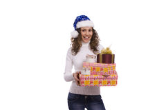 Woman dressing up in Christmas cap holding gift Royalty Free Stock Photography