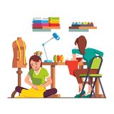 Woman dressmaker stitching, seamstress working. Woman dressmaker stitching sitting on floor, seamstress working with sewing machine. Tailor workshop with desk Stock Image