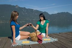 Woman driking some wine. Woman tasting of the wine at the edge of a lake Stock Images