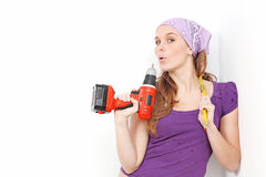 Woman with drill. Doing DIY home improvements Stock Image