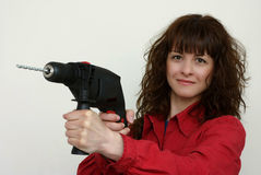 A woman and a drill Royalty Free Stock Image