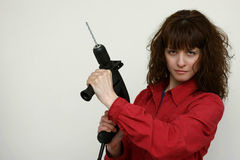 A woman with a drill Stock Image
