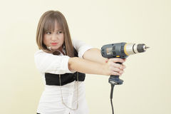 Woman with a drill Royalty Free Stock Photography
