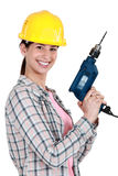 Woman with a drill Royalty Free Stock Image