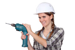 Woman with a drill Royalty Free Stock Photo