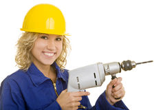 Woman with drill. Young woman with helmet and a drill machine stock images