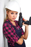 Woman with a drill Royalty Free Stock Images