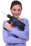 Woman with drill Royalty Free Stock Photos