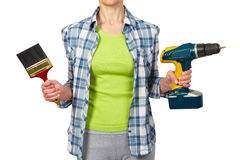 Woman with a drill. Royalty Free Stock Images