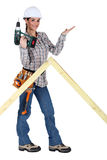 Woman with drill Stock Photo