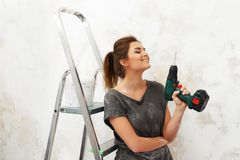 Woman with a drill Stock Images