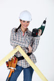Woman drilling hole Royalty Free Stock Photos