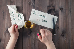 Woman drink alcohol and write message Stock Image