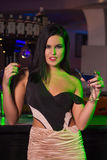 Woman with drink in bar Royalty Free Stock Photography