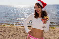 Woman with drink on the beach.  Christmas Vacation Stock Photography
