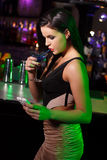 Woman drink blue vodka in bar Stock Images