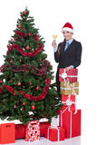 Woman drink a champagne and christmas tree Royalty Free Stock Photography