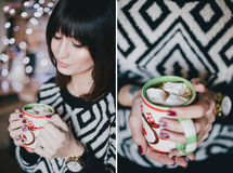 Woman drink cocoa with marshmallows in front of xmas lights Royalty Free Stock Image