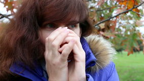 Woman drink coffee in autumn park.Outdoor stock footage