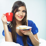 Woman drink coffee in bed. Royalty Free Stock Image