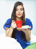Woman drink coffee in bed. Royalty Free Stock Photography
