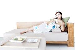 Woman drink coffee on sofa Royalty Free Stock Photo