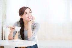 Woman drink coffee or tea Royalty Free Stock Photos
