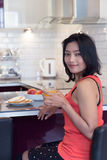 Woman with drink. And food at the bar kitchen Royalty Free Stock Image