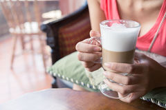 Woman drink a hot coffee. In cafe Royalty Free Stock Photography