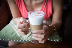 Woman drink a hot coffee. In cafe Stock Images