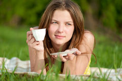 Woman drink hot coffee outdoor Stock Images