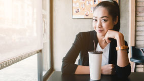Woman drink ice coffee. Royalty Free Stock Images