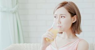 Woman drink juice. And feel happily at home royalty free stock images