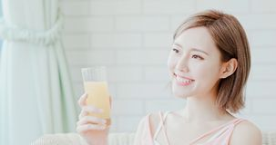 Woman drink juice. And feel happily at home royalty free stock photography