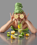 Woman with drink from lemon and lime Stock Photography