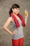 Woman drink orange juice after exercise Stock Images