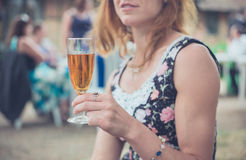 Woman with drink at party outside Royalty Free Stock Photos
